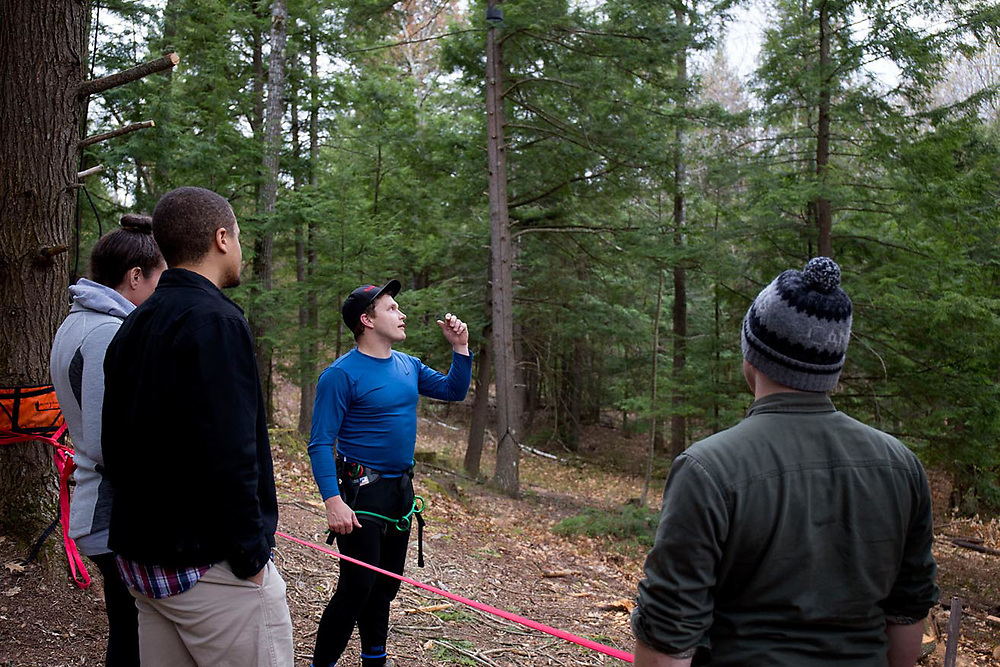 "Dan Walsh, of Concord, N.H., center, talks about the slacklines he is setting up in an amphitheater at Church of the Woods in Canterbury, N.H., on April 30, 2017. Slacklining is a recreational activity similar to tightrope walking. Walsh has been involved with the church for two years. ""It's always great coming back here,"" he said. ""It's a fun church."" (Photo by Geoff Hansen)"