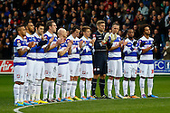 Picture by David Horn/Focus Images Ltd +44 7545 970036<br /> 07/12/2013<br /> Queens Park Rangers celebrate the life of Nelson Mandela with a minute's applause before the Sky Bet Championship match at the Loftus Road Stadium, London.