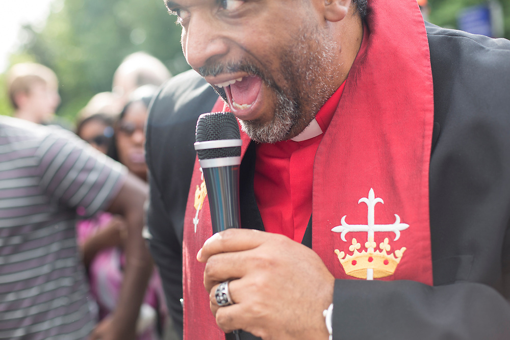 "N.C. NAACP President the Rev. William Barber leads a chant of ""forward together, not one step back"" with a crowd of hundreds gathered outside the North Carolina Legislature Building on Monday, May 20, 2013."