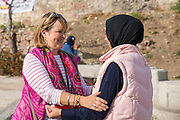 LESVOS, GREECE - NOV 6: Member of the German Bundestag Heike Hansel speaks with an Afghan refugee in Mytilene, Lesvos on November 6, 2016.