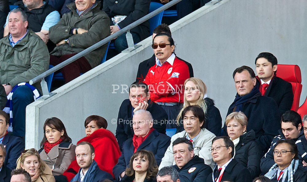 CARDIFF, WALES - Saturday, March 22, 2014: Cardiff City Chairman and owner Vincent Tan Chee Yioun stands wearing a Red home shirt to watch the Premiership match against Liverpool at the Cardiff City Stadium. (Pic by David Rawcliffe/Propaganda)