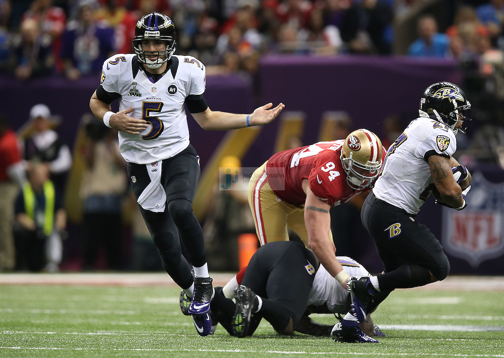 Joe Flacco (5) of the Baltimore Ravens hands of to Ray Rice (27) against the San Francisco 49ers during the NFL Super Bowl XLVII football game in New Orleans on Feb. 3, 2013. The Ravens won the game, 34-31.  (Photo by Jed Jacobsohn)