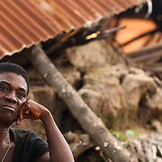 Amelie Adoko, 42, sits next to her destroyed home in the village of Kpoto, Benin on Tuesday October 26, 2010.  Waters have receded in Kpoto, but most of the village was literally flattened by floods that have hit Benin over the past few weeks..