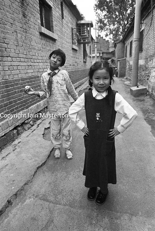 Two girls posing for the camera in a Beijing hutong in China