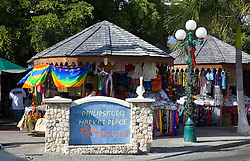 Philipsburg, St. Maarten:  Souvenir stands snag tourist dollars with colorful offerings in the city's public market.  One of the most sophisticated and developed cruise ports in the Caribbean, Philipsburg is known for its multiple high-end jewelry stores and beautiful beach.