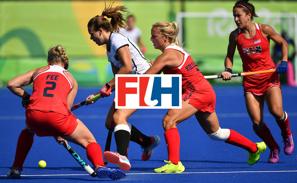 Germany's Anne Schroder (2nd L) vies with The USA's Stefanie Fee (L) and The USA's Kelsey Kolojejchick (2nd R) during the women's quarterfinal field hockey USA vs Germany match of the Rio 2016 Olympics Games at the Olympic Hockey Centre in Rio de Janeiro on August 15, 2016. / AFP / Pascal GUYOT        (Photo credit should read PASCAL GUYOT/AFP/Getty Images)
