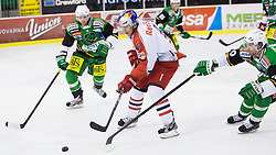 02.11.2012, Hala Tivoli, Ljubljana, SLO, EBEL, HDD Telemach Olimpija Ljubljana vs EC Red Bull Salzburg, 18. Runde, in picture Justin Di Benedetto (EC Red Bull Salzburg, #9) vs Igor Cvetek (HDD Telemach Olimpija, #4) and Brock McBride (HDD Telemach Olimpija, #10) during the Erste Bank Icehockey League 18th Round match between HDD Telemach Olimpija Ljubljana and EC Red Bull Salzburg at the Hala Tivoli, Ljubljana, Slovenia on 2012/11/02. (Photo By Matic Klansek Velej / Sportida)