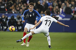 France's Benjamin Pavard battling Uruguay's Diego Laxalt during France v Uruguay friendly football match at the Stade de France in Saint-Denis, suburb of Paris, France on November 20, 2018. France won 1-0. Photo by Henri Szwarc/ABACAPRESS.COM