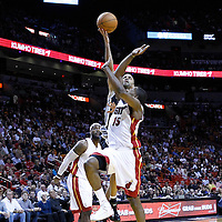 17 January 2012: San Antonio Spurs point guard Tony Parker (9) goes for the floater over Miami Heat point guard Mario Chalmers (15) during the Miami Heat 120-98 victory over the San Antonio Spurs at the AmericanAirlines Arena, Miami, Florida, USA.