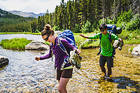 Kaitlyn Honnold and Chris Call make a stream crossing, Stough Creek Basin Trail, Wind River Range, Wyoming.