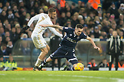 Leeds United Midfielder Kemar Roofe fouls Millwall Midfielder Shaun Williams during the EFL Sky Bet Championship match between Leeds United and Millwall at Elland Road, Leeds, England on 20 January 2018. Photo by Craig Zadoroznyj.