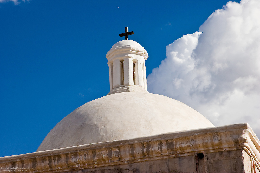 Cross and dome of the Spanish mission church in Tumacacori National Historical Park, Arizona