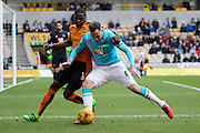 Derby County defender Richard Keogh holds off Wolverhampton Wanderers defender Jeremy Helan during the Sky Bet Championship match between Wolverhampton Wanderers and Derby County at Molineux, Wolverhampton, England on 27 February 2016. Photo by Alan Franklin.
