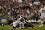 Twickenham, GREAT BRITAIN, Tigers Lewis MOODY is tackled by Quins Mel DEANE, during the Guinness Premiership match, NEC Harlequins and Leicester Tigers, at the Twickenham Stoop Stadium, ENGLAND, 23/09/2006. [Photo, Peter Spurrier/Intersport-images].