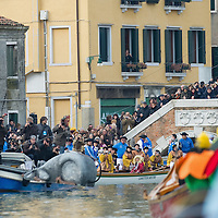 "VENICE, ITALY - FEBRUARY 20:  The ""Pantegana"" (mouse) touches the water after launch along the Cannaregio Canal during the Venetian Feast on February 20, 2011 in Venice, Italy. During the Venetian Feast a traditional water parade sails from San Marco along the Canal Grande to the  district of Cannaregio where there the crowd waits for the Svolo della Pantegana  (flight of the mouse)."