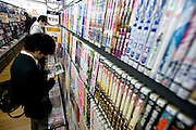 A boy looks at a manga in a section of  store containing stories on the theme of child sex in Tokyo, Japan  on 18 Feb. 2010.