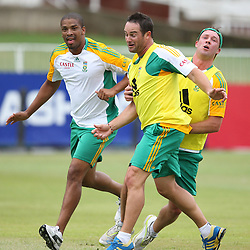 AB de Villiers tackles Mark Boucher wicketkeeper and Vernon Philander during the Castle Lager Proteas squad which came together in Durban on Friday December 23, in preparation for the second Sunfoil Test Match starting at Sahara Stadium Kingsmead on the Day of Goodwill (December 26). The squad had a practice session at Sahara Stadium Kingsmead on Friday 23rd afternoon from 14h00 until 17h00.<br /> <br /> <br /> Photography: Steve Haag