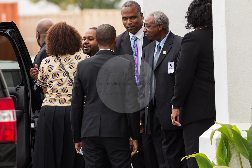 Superstar Pharrell Williams (back toward camera) thanks family members of the Charleston 9 shooting outside the historic Mother Emanuel AME Church after performing with the Gospel Choir during Sunday service November 1, 2015 in Charleston, South Carolina. The church was the site of the mass shooting that killed nine-people in June 2015 and will be featured is part of a program on race relations being produced by A+E Networks.