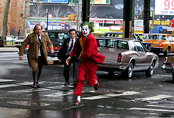 "Joaquin Phoenix in full joker costume and make-up is seen running at full speed while filming an intense scene where he is being pursued by costars Shea Whigham and Bill Camp who will be playing two Gotham Police Detectives for the upcoming JOKER movie. The scene involved a dangerous stunt where Joaquin's Stunt Double took a nasty hit by a taxi while filming under an elevated train station in the Bronx. Later in the day Joaquin was off his Joker costume and shot some gritty looking scenes as his other character known as ""Arthur Fleck"". 18 Nov 2018 Pictured: Joaquin Phoenix. Photo credit: LRNYC / MEGA TheMegaAgency.com +1 888 505 6342"