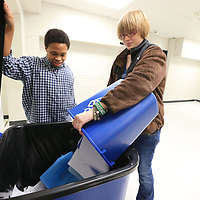 Tony Mays, left, and Kaylee Maddox empty teachers recycling baskets into one large bin as part of a recycling project at Tupelo Middle School.
