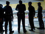 22 MAY 2015 - BANGKOK, THAILAND:  Thai police gather before an anti-coup protest at Bangkok Art and Culture Centre in Bangkok. The Thai military seized power in a coup on May 22, 2014. There were small protests throughout Bangkok Friday to mark the first anniversary of the coup. Police arrested protestors at several locations. The most serious protest was at Bangkok Art and Culture Centre (BACC) where about 100 protestors, mostly students, faced off against police for several hours. Police made numerous arrests at the BACC protest.    PHOTO BY JACK KURTZ