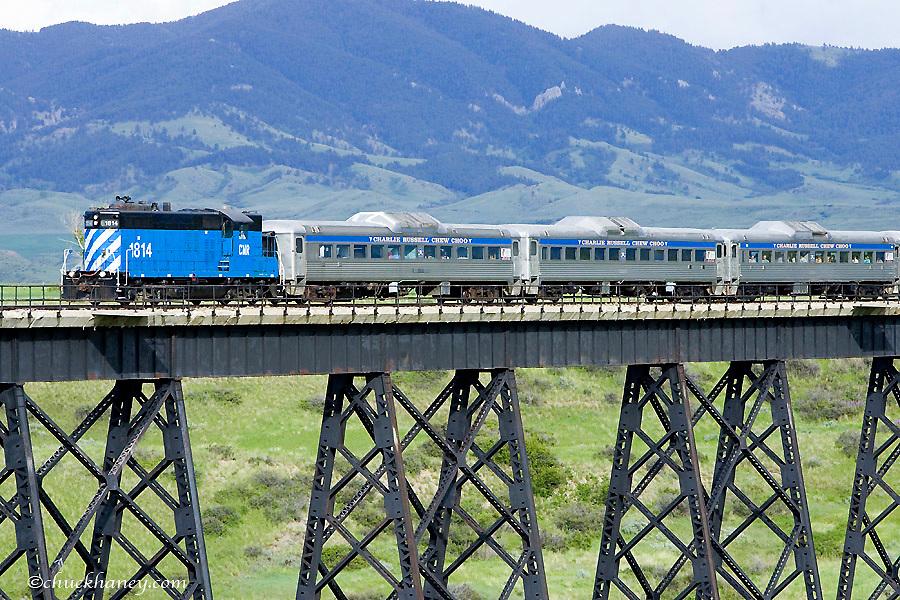 Charlie Russell Chew Choo Choo Train crosses Large trestle near Lewsiton Montana