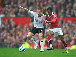 MANCHESTER, ENGLAND - Sunday, September 19, 2010: Liverpool's Joe Cole and Manchester United's Nani during the Premiership match at Old Trafford. (Photo by David Rawcliffe/Propaganda)