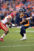 Kansas City Chiefs linebacker Dee Ford (55) sacks Denver Broncos quarterback Case Keenum (4) for a loss of 2 yards in the first quarter during the NFL week 4 regular season football game against the Denver Broncos on Monday, Oct. 1, 2018 in Denver. The Chiefs won the game 27-23. (©Paul Anthony Spinelli)