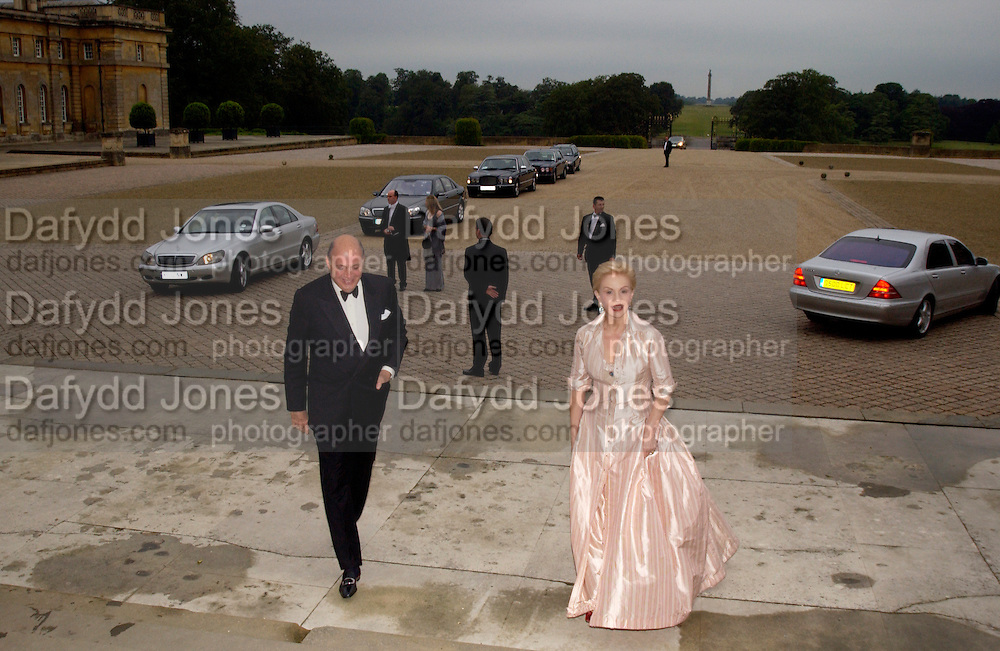 Reinaldo Herrera and Carolina Herrera, Ball at Blenheim Palace in aid of the Red Cross, Woodstock, 26 June 2004. SUPPLIED FOR ONE-TIME USE ONLY-DO NOT ARCHIVE. © Copyright Photograph by Dafydd Jones 66 Stockwell Park Rd. London SW9 0DA Tel 020 7733 0108 www.dafjones.com
