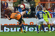 Jake Livermore of Hull City shoots at goal during the Sky Bet Championship match between Hull City and Birmingham City at the KC Stadium, Kingston upon Hull, England on 24 October 2015. Photo by Ian Lyall.