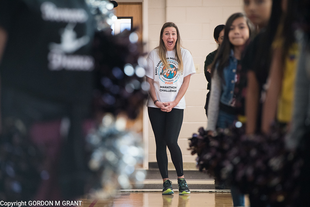 Cara Nelson, a 7th grade social studies teacher at the East Hampton Middle School, waits to be introduced during a sendoff in her honor, at the school in East Hampton, Jan. 18, 2018. Nelson will leave next week to participate in a trip where she will run seven marathons in seven days on seven continents.