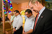 "13 OCTOBER 2010 - SOUTH TUCSON, AZ: Terry Goddard bows his head in prayer at the start Democratic ""Unity Rally"" at Rigo's in South Tucson. Goddard spent the day in Tucson campaigning. Goddard lost the election to sitting Governor Jan Brewer, a conservative Republican.     PHOTO BY JACK KURTZ"