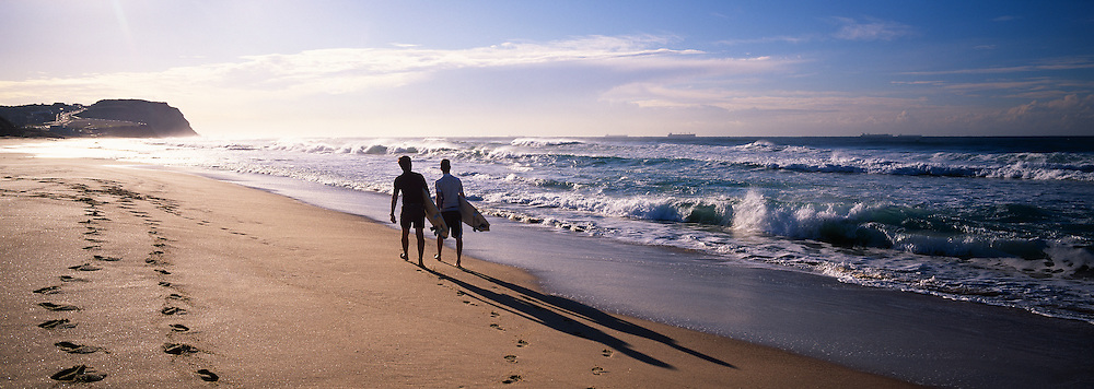 Father and son heading for the Surf, Newcastle Australia