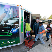 Thomas Wells   BUY AT PHOTOS.DJOURNAL.COM<br /> Miss New South Hannah Whitlock of Pontotoc, right, takes children into a mobile gaming trailer Whitlock is using to encourage more reading by giving away free gaming minutes for reading books.
