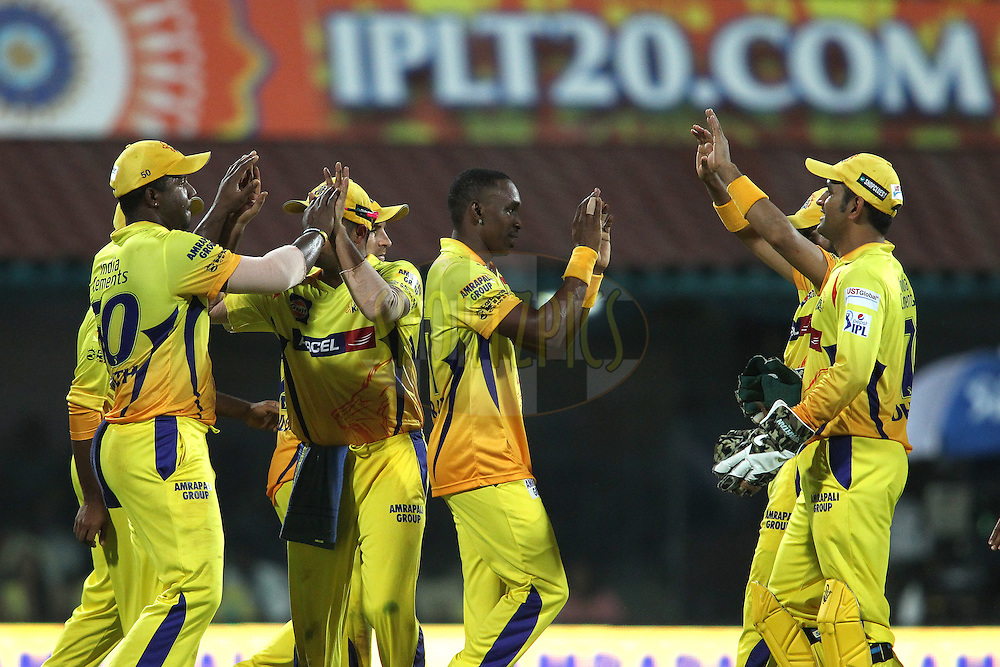 Dwayne Smith of Chennai Super Kings is congratulated by Suresh Raina of Chennai Super Kings for taking the catch to get Dinesh Karthik of the Royal Challengers Bangalore wicketduring match 37 of the Pepsi IPL 2015 (Indian Premier League) between The Chennai Superkings and The Royal Challengers Bangalore held at the M. A. Chidambaram Stadium, Chennai Stadium in Chennai, India on the 4th May April 2015.<br /> <br /> Photo by:  Shaun Roy / SPORTZPICS / IPL