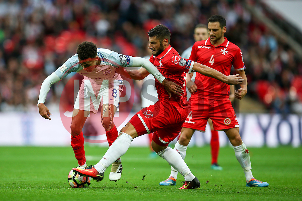 Dele Alli of England is tackled by Ryan Camilleri of Malta - Mandatory by-line: Jason Brown/JMP - 08/10/2016 - FOOTBALL - Wembley Stadium - London, United Kingdom - England v Malta - FIFA European World Cup Qualifiers