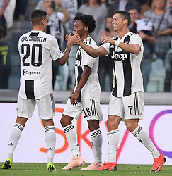 TURIN, Oct. 21, 2018  Juventus' Cristiano Ronaldo (R) celebrates his goal with teammates during an Italian Serie A soccer match between FC Juventus and Genoa in Turin, Italy, Oct. 20, 2018. The match ended 1-1. (Credit Image: © Alberto Lingria/Xinhua via ZUMA Wire)