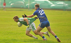 Burrischoole's Alan Ryder tries to get past Hollymount-Carramore's Barry Sheridan during the Intermediate championship match on saturday evening last.<br /> Pic Conor McKeown