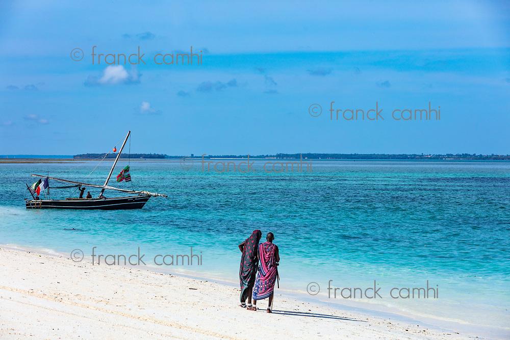 Kendwa, Zanzibar-March 4, 2019 : Masai people looking at boat on Kendwa beach