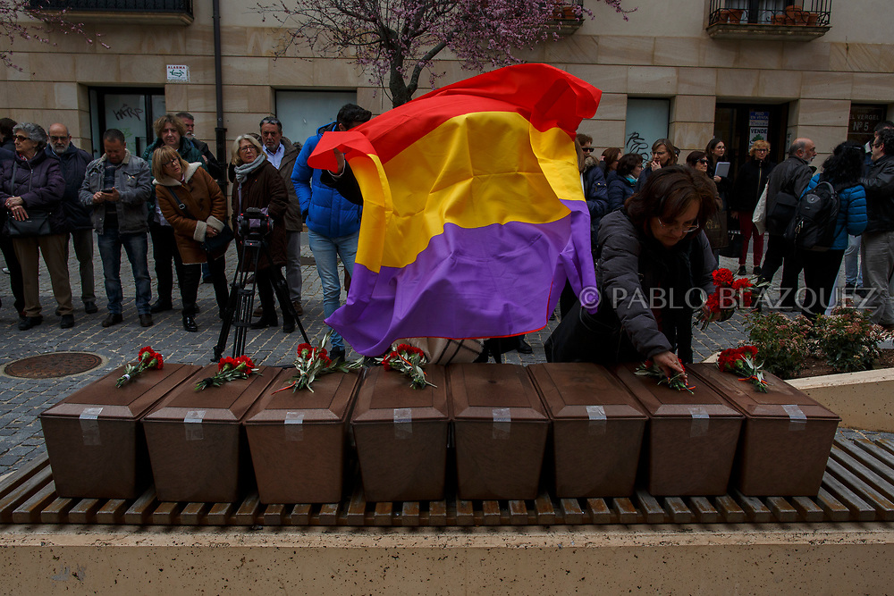 14/04/2018. A Spanish republican flag is placed on top of coffins containing the bodies of victims of Spain Civil War exhumed in Cobertelada and Calata&ntilde;azor during a homage to hand the remains to their relatives on April 14, 2018 in Soria, Spain. La Asociacion Soriana Recuerdo y Dignidad (ASRD) 'The Soria Association for Memory and Dignity' celebrated a tribute to hand over the remains of civil war victims to their families. The Society of Sciences of ARANZADI helped with the research, exhumation and identification of the bodies, after villagers passed the information about the mass grave, 81 years after the assassination took place, to the ASRD. Seven people were assassinated around August 25, 1936 by Falangists, as part of General Francisco Franco armed forces, and buried in the 'Fosa de los Maestros' (Teachers Mass Grave) near Cobertelada, Soria, after being taken from prison of Almazan during the Spanish Civil War. Five of them were teachers in the region, and also friends of Spanish writer Antonio Machado. The other two still remain unidentified. Another body was assassinated by Falangists accompanied by a priest in 1936, and was exhumed on 23 September of 2017 near Calata&ntilde;azor, Soria. It belonged to Abundio Andaluz, a politician, lawyer and musician in Soria.<br /> Spain's Civil War took the lives of thousands of people on both sides, and civilians. But Franco continued his executions after the war has finished. Teachers, as part of the education sector, were often a target of Franco's forces. Spanish governments has never done anything to help the victims of the Civil War and Franco's dictatorship while there are still thousands of people missing in mass graves around the country. (&copy; Pablo Blazquez)