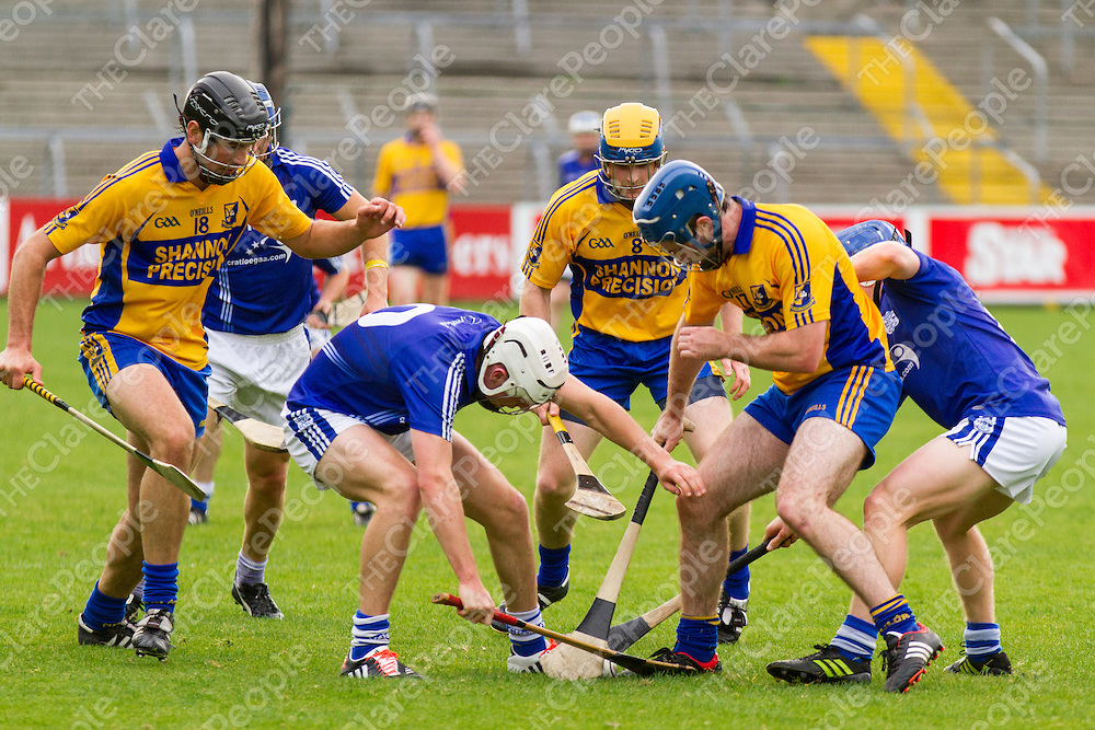 Cratloe's Shane Gleeson attempts to take the slíotar from SIxmilebridge's Noel Purcell, Seadna Morey and Rory Shanahan