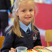 Sadhbh Lyons keeps busy on her First day at school at Scoil Na Mainistreach Quin Dangan