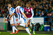 Aston Villa forward Jonathan Kodjia (26)   watches as Huddersfield Town defender Michael Hefele (44)   clears the ball during the EFL Sky Bet Championship match between Huddersfield Town and Aston Villa at the John Smiths Stadium, Huddersfield, England on 7 March 2017. Photo by Simon Davies.