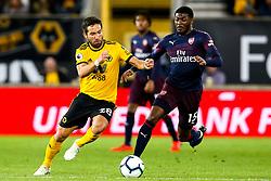 Joao Moutinho of Wolverhampton Wanderers takes on Ainsley Maitland-Niles of Arsenal - Mandatory by-line: Robbie Stephenson/JMP - 24/04/2019 - FOOTBALL - Molineux - Wolverhampton, England - Wolverhampton Wanderers v Arsenal - Premier League