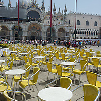 Empty tables and chairs at a cafe in St Mark's Square due to the heat on the day the Italian Government and Heath Ministry has issued several warning for the current heath wave