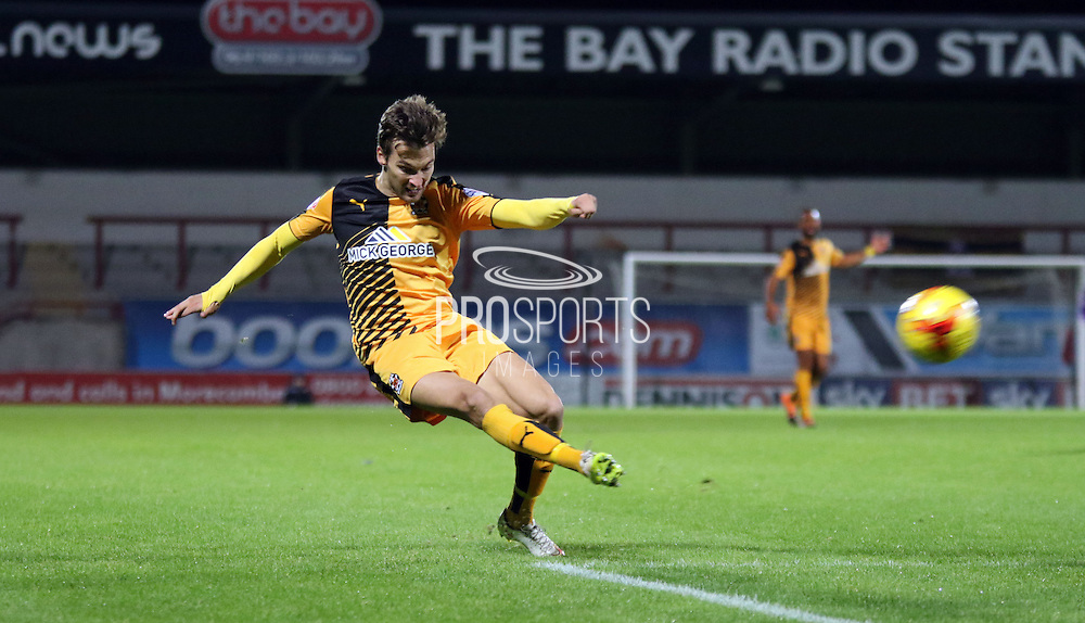 Ryan Donaldson strikes during the Sky Bet League 2 match between Morecambe and Cambridge United at the Globe Arena, Morecambe, England on 24 November 2015. Photo by Pete Burns.