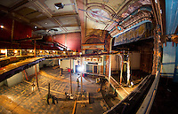 A great view from the upper right balcony box overlooking the main floor and stage area as the final pieces of steel joists are removed from the Colonial Theater on Wednesday morning.  (Karen Bobotas/for the Laconia Daily Sun)