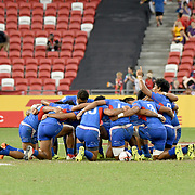 Manu Samoa elevated its performance this week at the Singapore 7's, and showed a spiritual reverence before their games.  New Zealand prevailed over Samoa 36-17 in the match for 5th place at the Singapore National Stadium, Singapore, Singapore.  Photo by Barry Markowitz, 4/29/18, 9pm