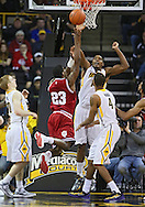 December 31 2012: Iowa Hawkeyes forward Melsahn Basabe (1) blocks a shot by Indiana Hoosiers guard Remy Abell (23) during the first half of the NCAA basketball game between the Indiana Hoosiers and the Iowa Hawkeyes at Carver-Hawkeye Arena in Iowa City, Iowa on Monday December 31, 2012. Indiana defeated Iowa 69-65.