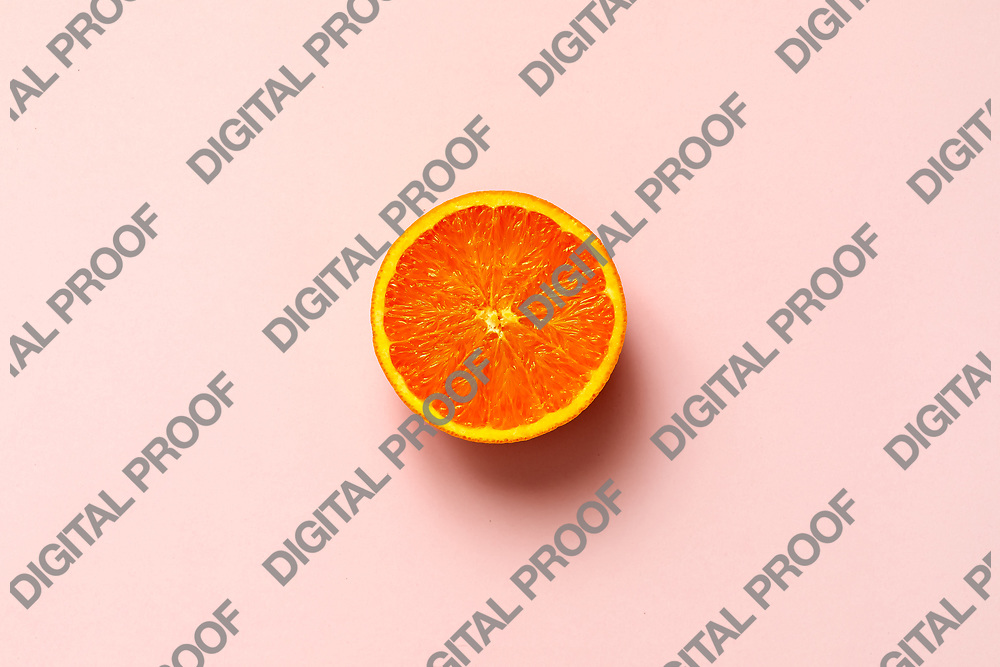 Orange fruit. Orange half fruit sliced isolate on pink background seen from above flatlay style, close up.
